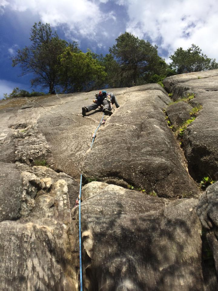 Leading a crack route in Smoke Bluff, Squamish BC.